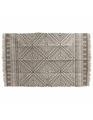 Cree un ambiente cálido y auténtico en su hogar con esta alfombra de inspiración étnica en blanco y negro.